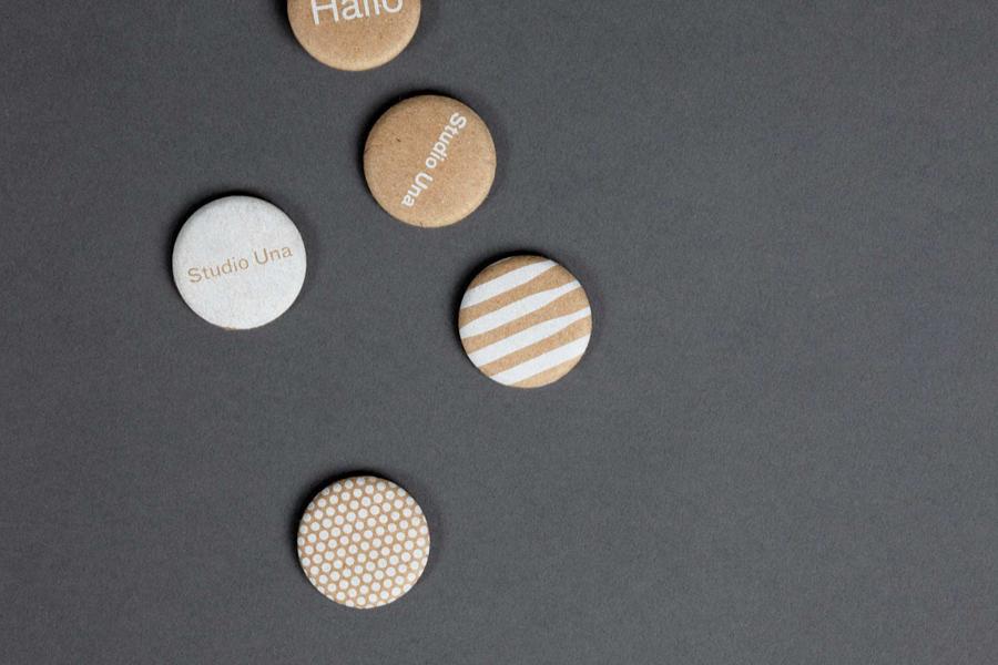 12-Studio-Una-Brand-Identity-Badges-Buttons-BPO